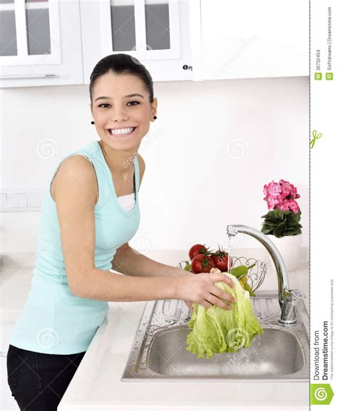waters in the green kitchen beautiful washing vegetables stock images image 9011
