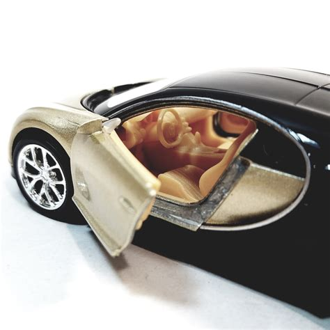 "Bear in mind that a standard bugatti chiron costs around $2.5 million to start with. Welly. Bugatti Chiron Cream & Black Hard Top 4.5"" Scale Diecast Car   Enigmatoys"