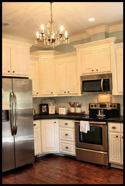 what color appliances with white cabinets white cabinets and dark floors stainless and chandelier 912 | 892c3aa40202755a247b831bf043c898