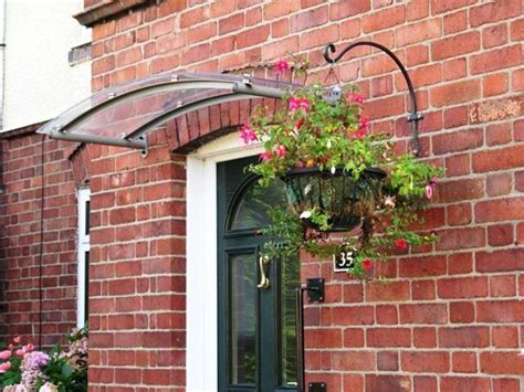 Arched Glass Canopy (awning).... Check Out The Awning We