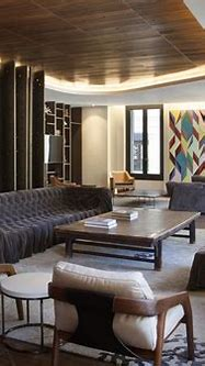 Wood in interior design: Afro-contemporary apartment by ...