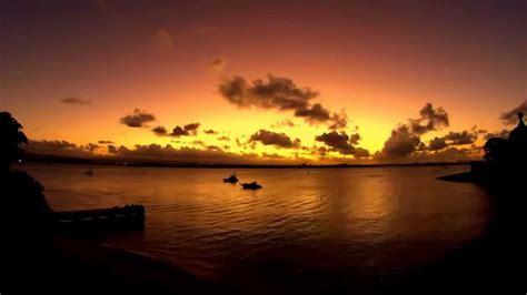 sunset sailboats pelicans feeding san juan bay puerto