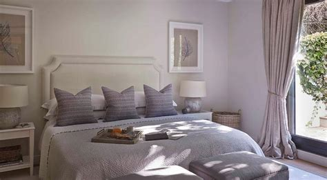 Purple And Gray Bedroom With Stools At Foot Of The Bed