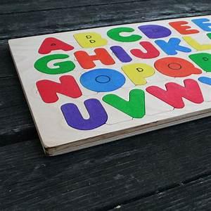 Wooden alphabet puzzle the puzzle man for Wooden letter puzzle