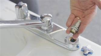 video how to repair a dripping kitchen two handle faucet