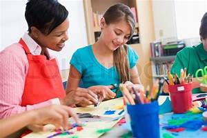 Elementary pupil in art class with teacher | Stock Photo ...