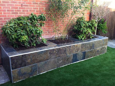 Raised Flower Garden Designs create a stunning raised flower bed in your garden with