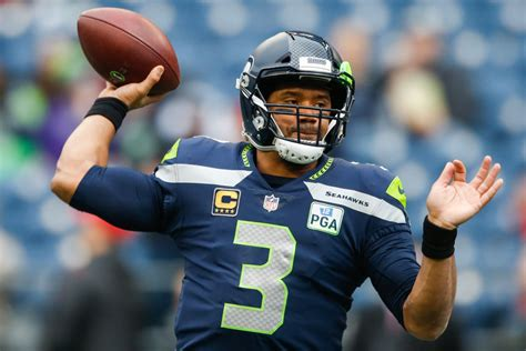russell wilson  highest paid nfl player  seahawks