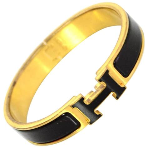 hermes black and gold narrow enamel h clic clac bangle bracelet pm for sale at 1stdibs