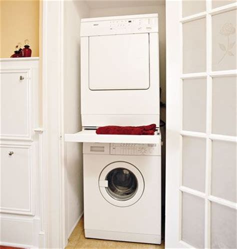 laundry room in closet holding a stackable washer dryer