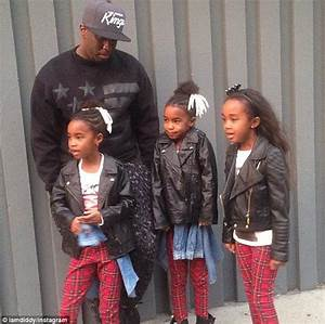 Diddy poses with his six children for family Christmas ...