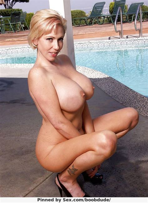 sexy busty blonde squatting naked boobdude
