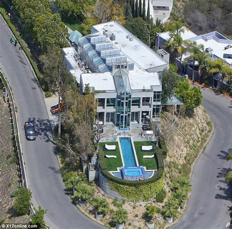 rihanna snaps up luxury mansion on hairpin turn in daily mail