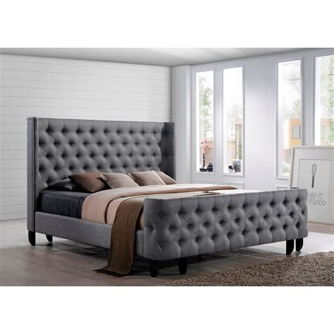 gray tufted bed bed a button tufted winged headboard and footboard