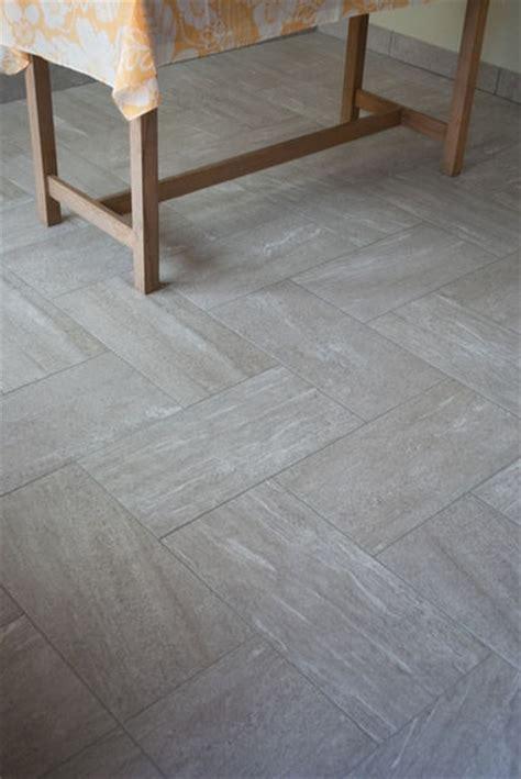 large format herringbone tile back porch tile