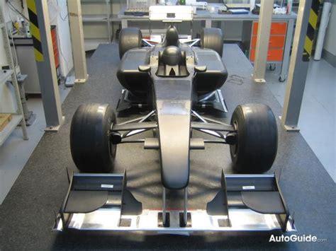 report lotus unveils  wind tunnel test car announces