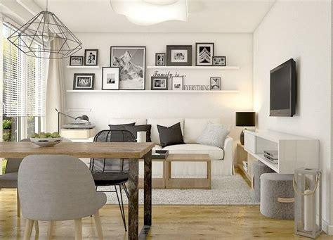 kleines wohnzimmer mit essplatz  weiss schwarz und holz