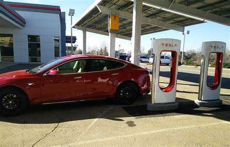 update teslas  solar powered supercharger store service center  open