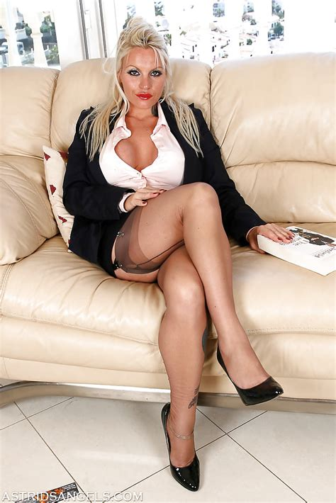 busty mature blonde in business clothes and nylons sets