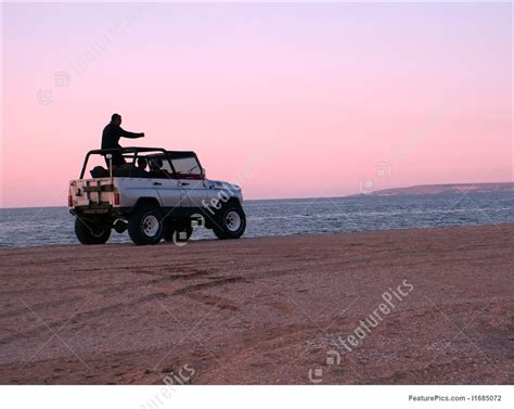 jeep beach sunset unpaved road sunset jeep driving stock picture i1685072