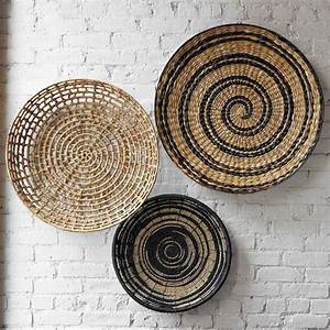 Decorating home with ethnic wicket dishes and bowls