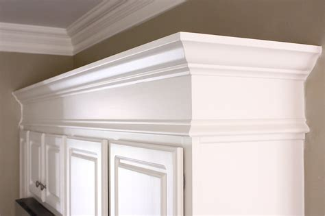 crown molding on top of cabinets the yellow cape cod making cabinets taller builder