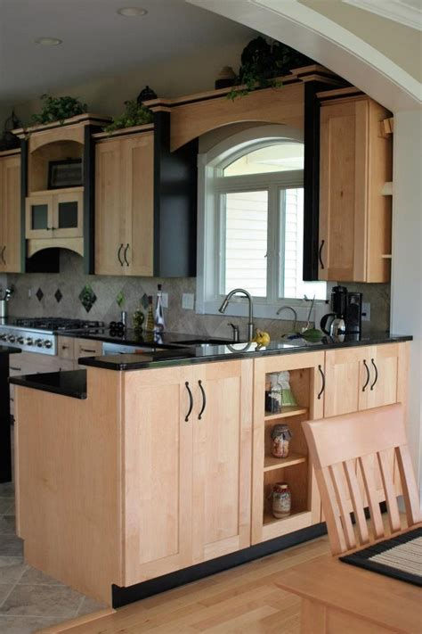 maple cabinets with granite countertops maple kitchen cabinets with black accent trim