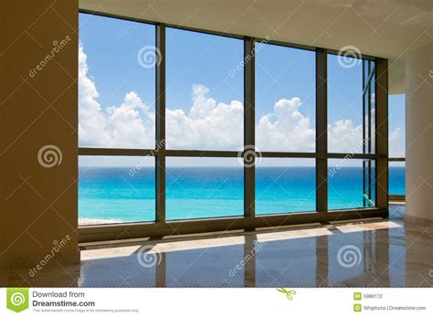 view  tropical beach  hotel windows stock