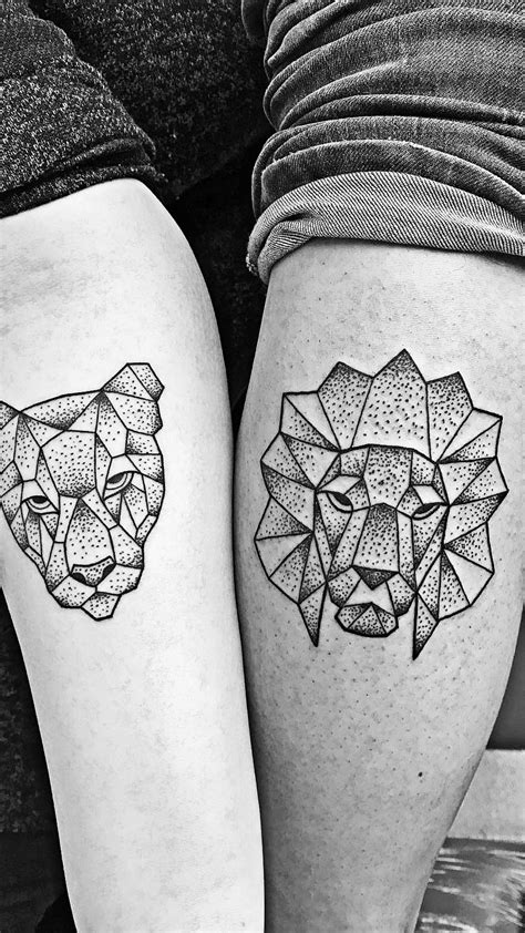 Geometric lion and lioness as couple tattoo. I chose the lion for my calf and my girlfriend got