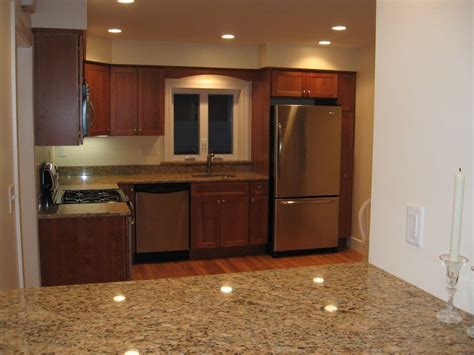 Renovated kitchen with granite counters, cherry cabinets