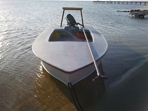 Bow And Stroke Side Of A Boat by Custom Flats Skiffs
