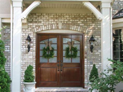 Double Doors- Double Wreaths. Love The Simple Green