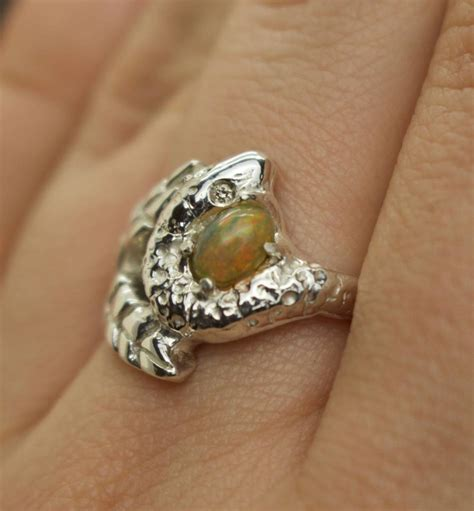 snake and leaf engagement ring with opal and diamonds by