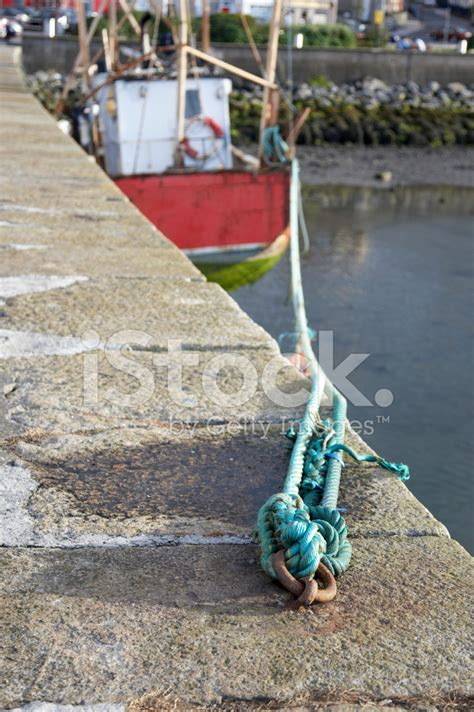 Boat And Mooring by Fishing Boat And Mooring Rope Stock Photos Freeimages