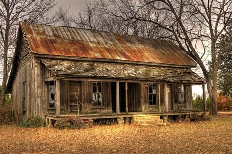 abandoned tiny cabin  rusty corrugated metal roofthink   stories  house