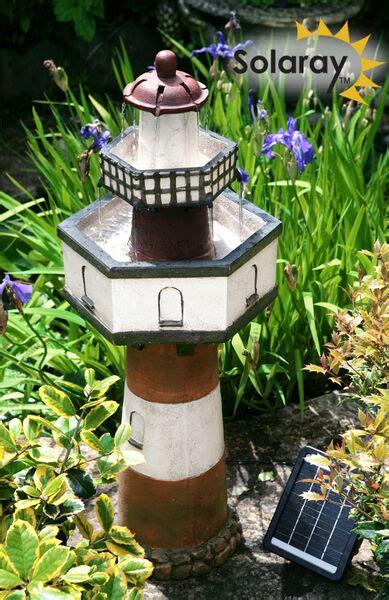solar lighthouse cascade water fountain  tier garden yard
