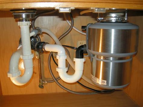 how to stop disposal from backing up into other sink new disposal 48 hours terry love plumbing remodel