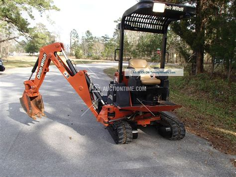 ditch witch xt mini excavator tool carrier skid steer  ten attachments