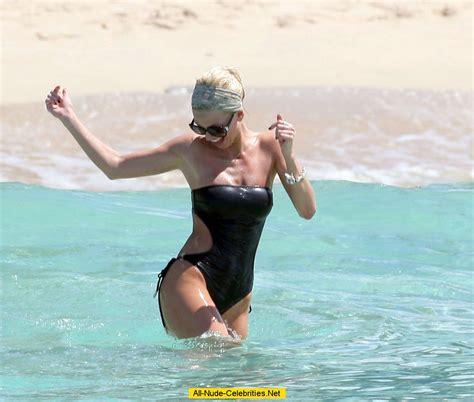 Sarah Harding in bikini on the beach in Barbados