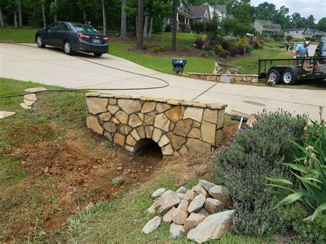 Image result for block retaining wall built around a drain pipe