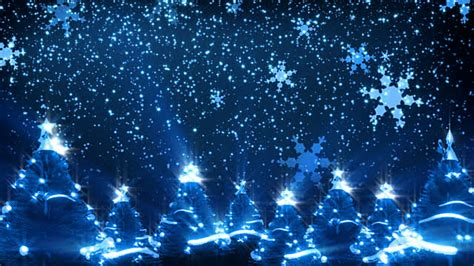 christmas lights snowflakes falling cgi snowflakes falling on illuminated trees stock footage getty images