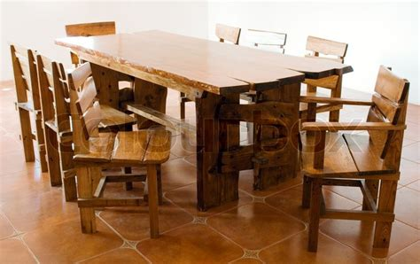 large wooden table and chairs stock photo colourbox