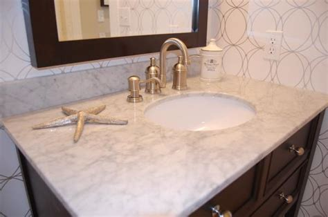 White sink with brushed nickel faucet, bathrooms with