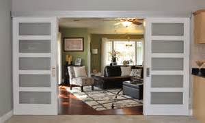 johnson hardware 200wm separating two living rooms interior barn door contemporary living