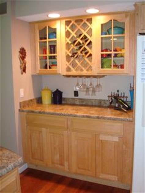 changing kitchen cabinets make space for wine bottles by removing the door on a base 2080