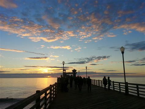 picture sunrise pier shadow sunlight water