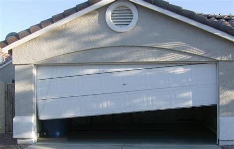 Garage Door Repair Diy by Garage Door Repair Diy Adjusting Your Garage Door