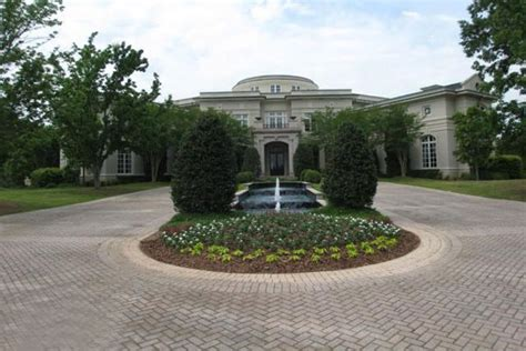 Rick Ross S House by Rick Ross Buys Evander Holyfield S Former Mansion