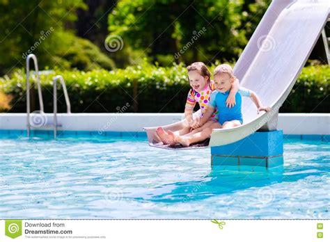 Kids On Water Slide In Swimming Pool Stock Photo Image