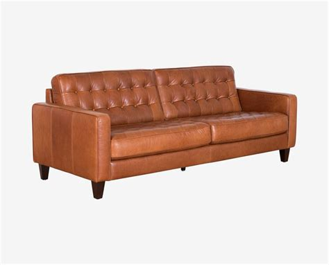 oasis darrin leather sofa dania the gustav sofa features a button tufted design